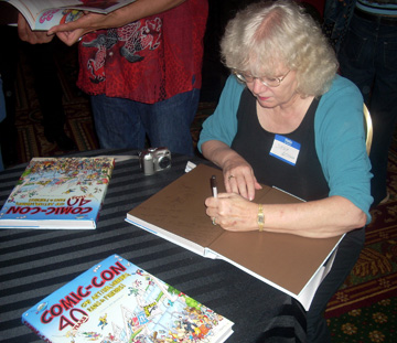 Jackie Estrada signing books at the 2009 Comic-Con 40th-anniversary party.